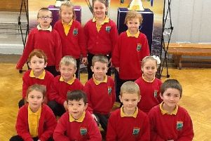 Shilbottle Primary School pupils with the rugby trophies at their school.