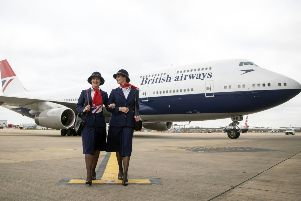 Ambassadors Elysa Marsden (left) and Olivia Welch in front of a Boeing 747 in British Airways Negus livery, part of British Airways' centenary fleet, arriving at London's Heathrow Airport. PRESS ASSOCIATION Photo. Photo: Steve Parsons/PA Wire