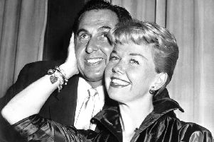 Doris Day poses with her husband and agent Martin Melcher in 1955
