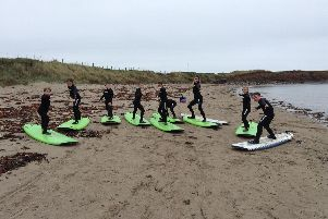 Pupils at Seahouses Primary School get to work on their surfing skills before taking to the water.