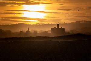 Sunset over Warkworth Castle. Picture by Ivor Rackham.