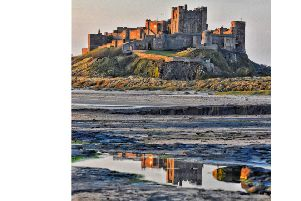 FIRST: Bamburgh Castle reflected in a pool on the wet sand by Darren Chapman. 825 Facebook likes