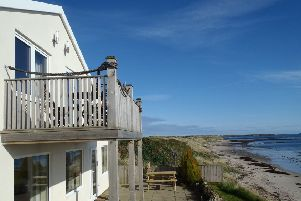 The holiday lets overlooking the beach at Beadnell.