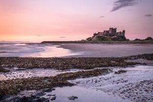 Bamburgh Castle in the distance of the newly voted best beach in Britain.