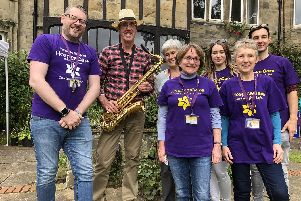 HospiceCare North Northumberland team at an open garden event at Alnmouth Friary during the Alnmouth Arts Festival weekend. Pictures are CEO Paul Jones; saxophonist Andrew Taylor; Dr Jane Lothian, vice-chairman of the board of trustees; and volunteers Tracy Jones, Jan McCarthy and Rachel and Liam Dodd.