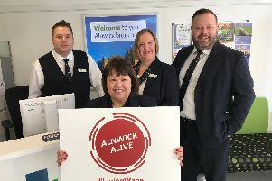 The Alnwick branch of Newcastle Building Society was the first company to sign up to Alnwick Alive, after being accredited by the Living Wage Foundation. Pictured are branch manager Greg Brown (right) and his team.