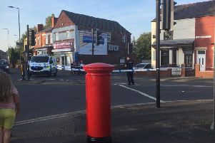 Bickershaw Lane is taped off by police after the latest shooting