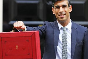 Chancellor Rishi Sunak poses for the cameras outside Downing Street. Pic: PA