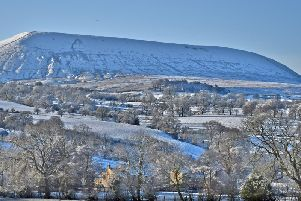 John Toms photograph of  Pendle Hill covered in snow shows off the landmark beautifully.