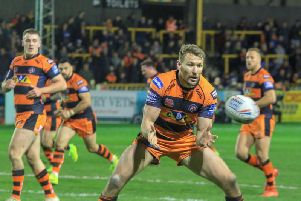 Michael Shenton looks to get a pass away in Castleford Tigers' game against St Helens. Picture: Simon Hall