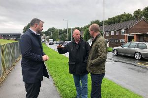 Andrew Stephenson MP, Marsden Coun. Neil McGowan and Lead Member for Highways Andrew Snowden outside Castercliffe Primary where the new markings will be added