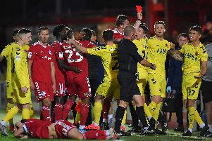 Harrison Biggins is shown a red card