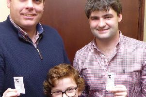 Lucy, with her dad Richard (left) and Tom, is pictured with the two winning tickets.