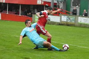 Lee Pugh is tackled in the Marske penalty area