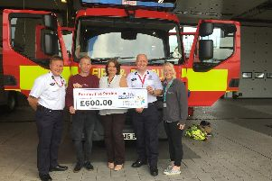 Pictured at the presentation to Pendleside Hospice are (from left to right) service delivery manager Steve Barnes, Burnley firefighter and race winner Adrian Cheetham, service delivery support Pauline Pilkington, group manager Shaun Walton and community fundraiser at the hospice Hospice Leah Hutchinson