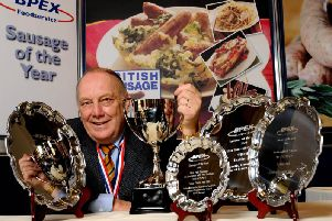 Kevin Berkins with his trophies