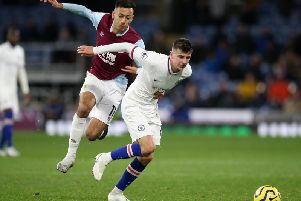Burnley winger Dwight McNeil in pursuit of Chelsea midfielder Mason Mount