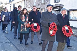 Clitheroe residents remember the fallen soldiers. Picture by Ken Geddes