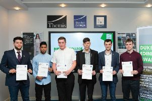 Some of the former students with their rewards