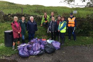 Some of the volunteers with the rubbish collected