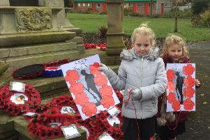 Two of the pupils from Springfield Primary School pay their respects at Sough War Memorial to remember the fallen.