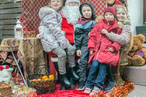 Children meet Father Christmas at the Christmas in Colne event. (photo by Naz Alam)