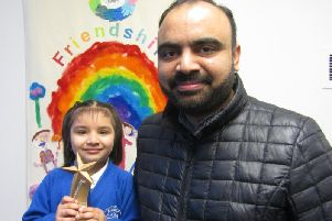 Tasqeen with her father and her award.