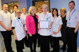 Catherine (centre, right) receives her Employee of the Month awards from ELHT Director of Communications Christine Hughes, watched by her podiatry colleagues