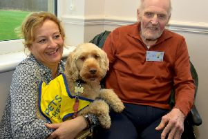 Millie with Jon and owner Ruth Chew.