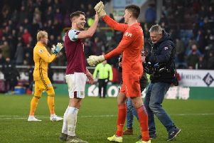 Burnley's James Tarkowski with goalkeeper Nick Pope