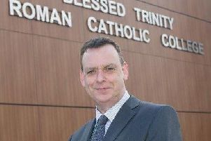 Mr Richard Varey, who is head of Blessed Trinity RC College in Burnley,  has given an assurance that becoming an academy will not mean major changes.