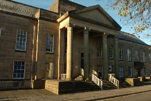 Burnley Magistrates Court were told how a woman hit a shop assistant in the face after she was asked to leave a Nelson store.