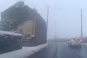 The taxi on the wrong side of the road approaching a bend