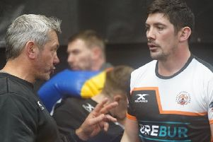 Castleford Tigers' new signing Chris Clarkson gets instructions from head coach Daryl Powell.