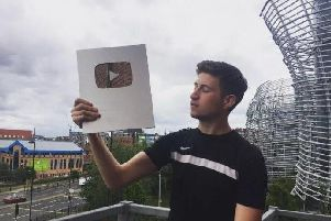 Burnley YouTuber Vizeh with his plaque for reaching 100,000 subscribers.