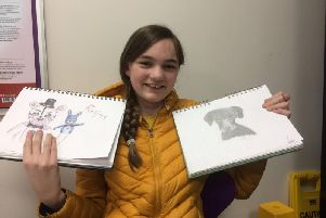 Autumn poses with two of her favourite pieces of art work.