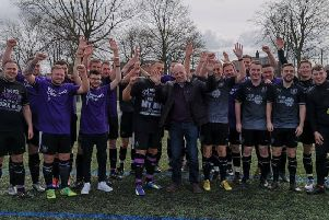 Matt and his dad Paul (centre front) with some of the players at the football tournament that has raised 10,500 for Pancreatic Cancer UK.