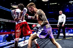 Sam Larkin (purple shorts) in action on his debut against Ricky Leach at Bolton Whites Hotel