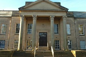 A court was told how a man defaced a toilet cubicle with spray paint after rowing with his girlfriend.