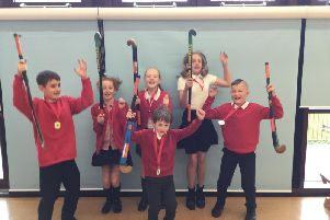The winners! The triumphant team from Earby Springfield Primary School celebrate their win in the Pendle School hockey tournament.