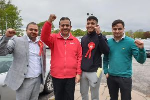Labour's Coun. Mohammed Iqbal (red top) celebrates a good day for Pendle Labour