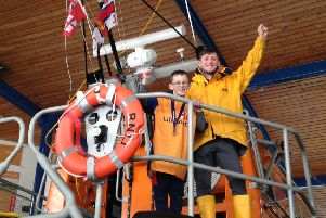 Six-year-old Dominic Stevens with RNLI crew member Josh Willder