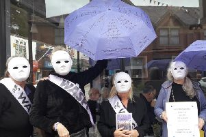 Silent Waspi protestors outside The Coffee Club in Market Street, Chorley