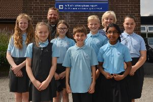 """St Anne�""""s C of E Primary School have recently been awarded Excellent in a Church schools inspection, pictured are children of the school worship group and school ambassadors with headteacher Clare Middleton and Rev Dave"""