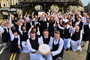 Staff at Bettys tearooms in Harrogate celebrate its 100th birthday.