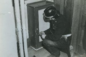 Firefighter examines the scene following an IRA bomb attack at Blackpool Town Hall on August 26, 1939