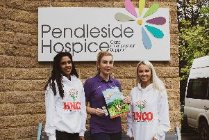 Volunteers from theHajjah NazihaCharitable Organisation handed out specially-designedactivity books to service users and visitors atPendleside Hospice.