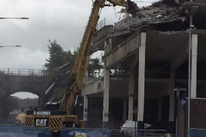 The old multi-storey car park is being knocked down