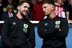 BURNLEY, ENGLAND - AUGUST 10: Robert Brady of Burnley speaks to Danny Drinkwater of Burnley prior to the Premier League match between Burnley FC and Southampton FC at Turf Moor on August 10, 2019 in Burnley, United Kingdom. (Photo by Alex Livesey/Getty Images)