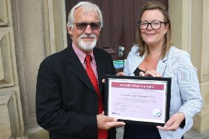 Vicki Turner receiving the certificate from Coun. Emo